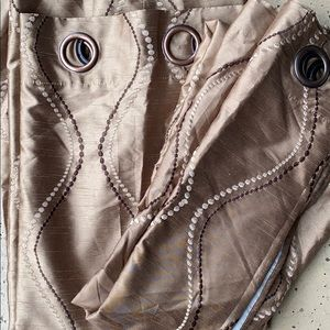 Brown and cream stitching on tan drapes